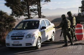 メキシコ麻薬戦争激化・ボンネットに5人の晒し首